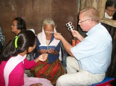 Dr. Curtis conducting eye clinic in India.